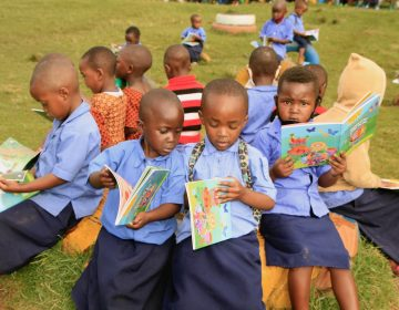 Preschoolers in Rwanda look at the books created for them by String Theory School students in Philadelphia. (Provided by String Theory Schools)