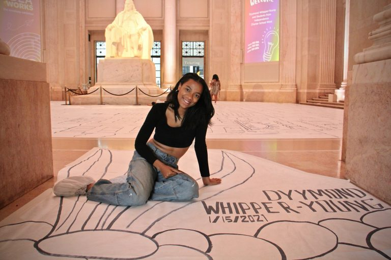 Dyymond Whipper-Young, an art teacher at Independence Charter School created a world-record-breaking drawing for the Franklin Institute's Creativitiy Exhibition. (Emma Lee/WHYY)
