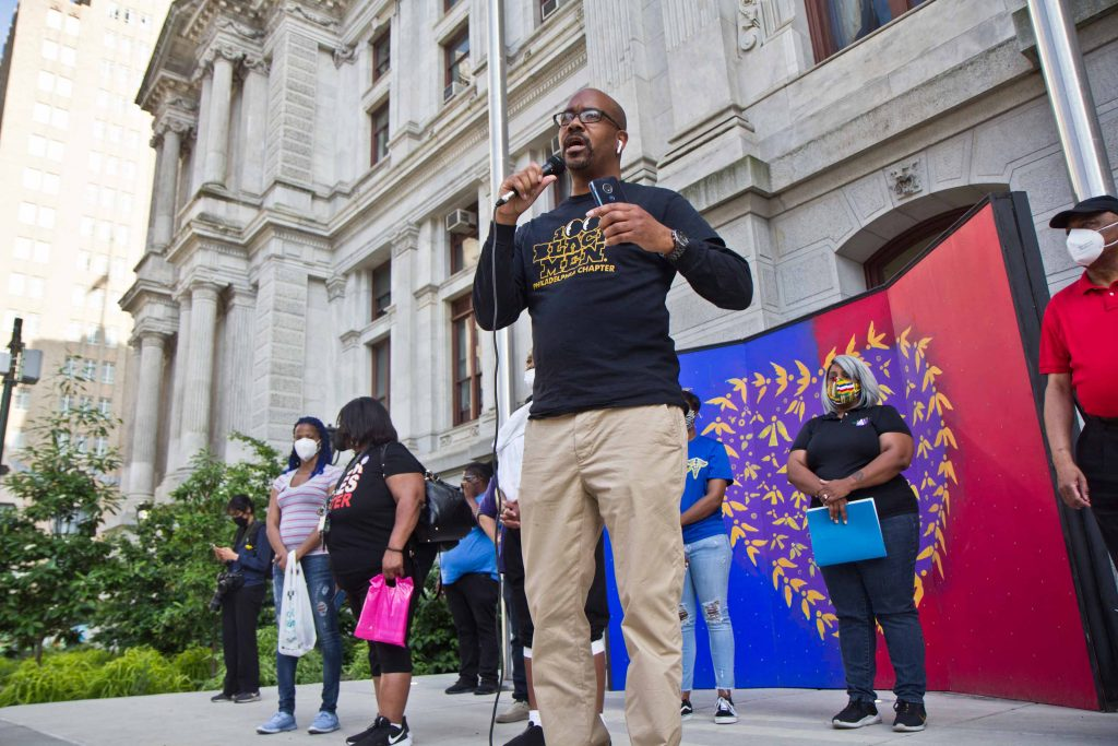 Joel Wilson, president of the Philadelphia chapter of 100 Black Men, speaks at a vigil for George Floyd outside City Hall in Philadelphia on May 25, 2021. (Kimberly Paynter/WHYY)