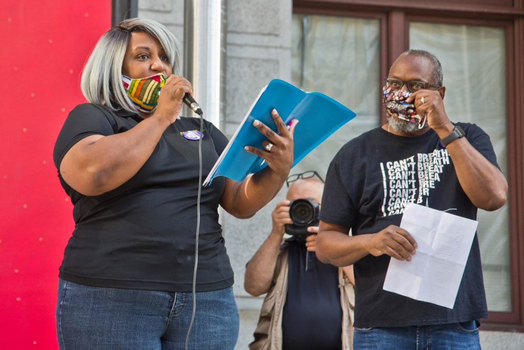 Ethelind Baylor. organizer with the Labor for Black Lives Coalition, led a vigil for George Floyd on the one-year anniversary of his death outside Philadelphia's City Hall on May 25, 2021. (Kimberly Paynter/WHYY)