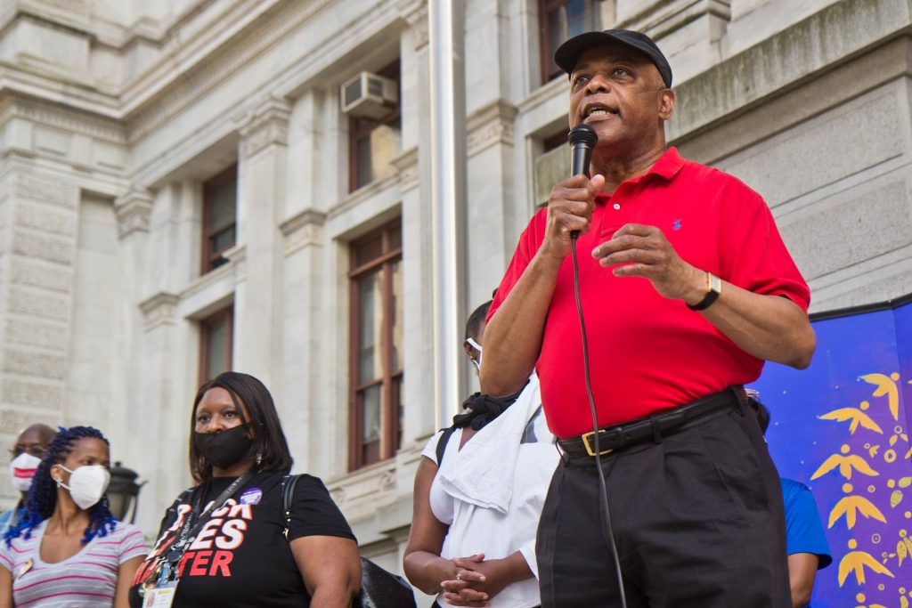 Jerry Jordan, president of the Philadelphia Federation of Teachers, spoke of education woes like toxic school buildings and overcrowding at a vigil for George Floyd on the one-year anniversary of his death outside Philadelphia's City Hall on May 25, 2021. (Kimberly Paynter/WHYY)