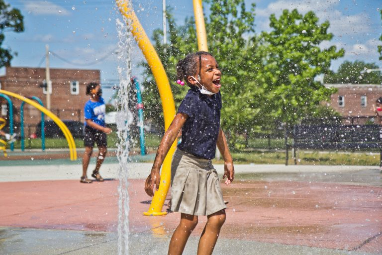 A child plays at a Philly sprayground
