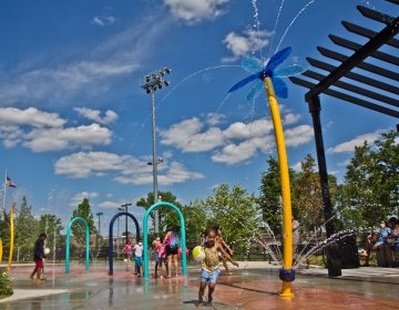 Elated children at Finley Recreation Center in Philadelphia run through the sprayground on the first day of operation, May 27, 2021. (Kimberly Paynter/WHYY)