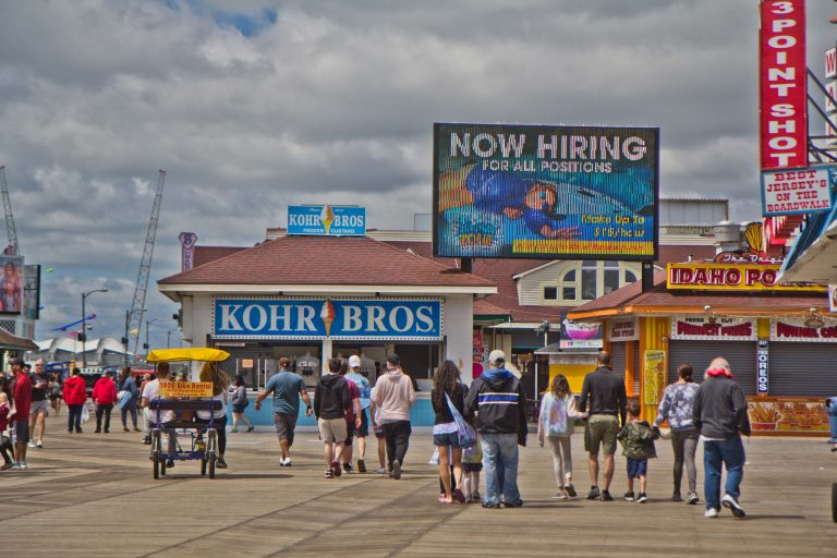 Morey's Pier on the Wildwood Boardwalk advertises $15 an hour jobs on May 31, 2021, Memorial Day. (Kimberly Paynter/WHYY)