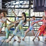 Dancers (Charlie Clinton, Isabella Diemedio, Grace Hill, Garrit McCabe, Corinne Mulch, Victoria Casals Rennet and Ben Schwarz) from the Pennsylvania Ballet preview choreographer Maria Konrad's piece PHrenetic, featuring original music from Philadelphia artist Sigmund Washington at the Cherry Street Pier on May 6, 2021. (Kimberly Paynter/WHYY)