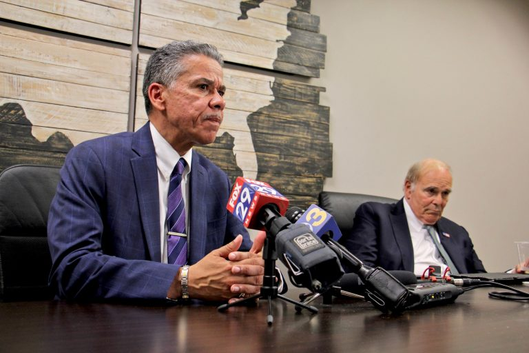 Carlos Vega, candidate for Philadelphia district attorney, speaks after getting the endorsement of former Pennsylvania Gov. Ed Rendell (right). (Emma Lee/WHYY)