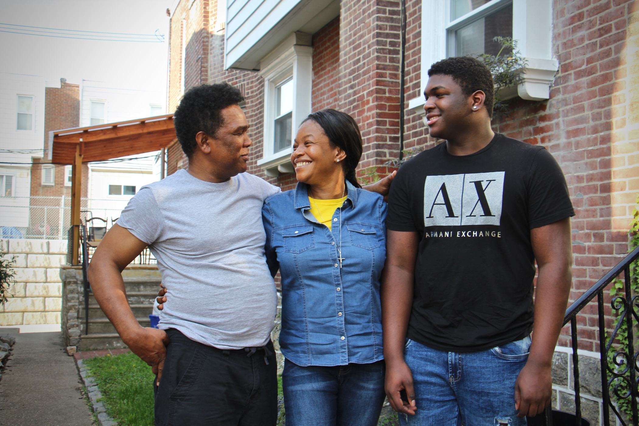 Clive and Oneita Thompson, with their son, Timothy, outside their West Philly home
