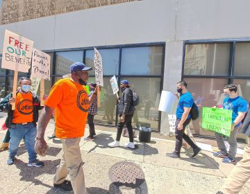Two dozen people in Philadelphia call on the state to process their unemployment applications during a protest on May 6, 2021. (Ximena Conde/WHYY)