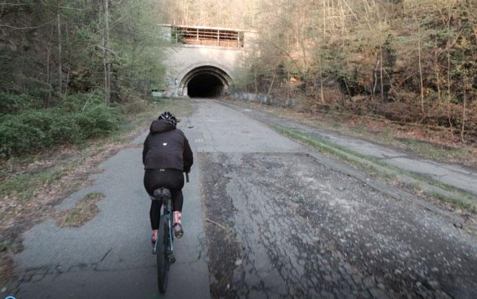 A participant rides their bike through an abandoned Pennsylvania Turnpike tunnel.