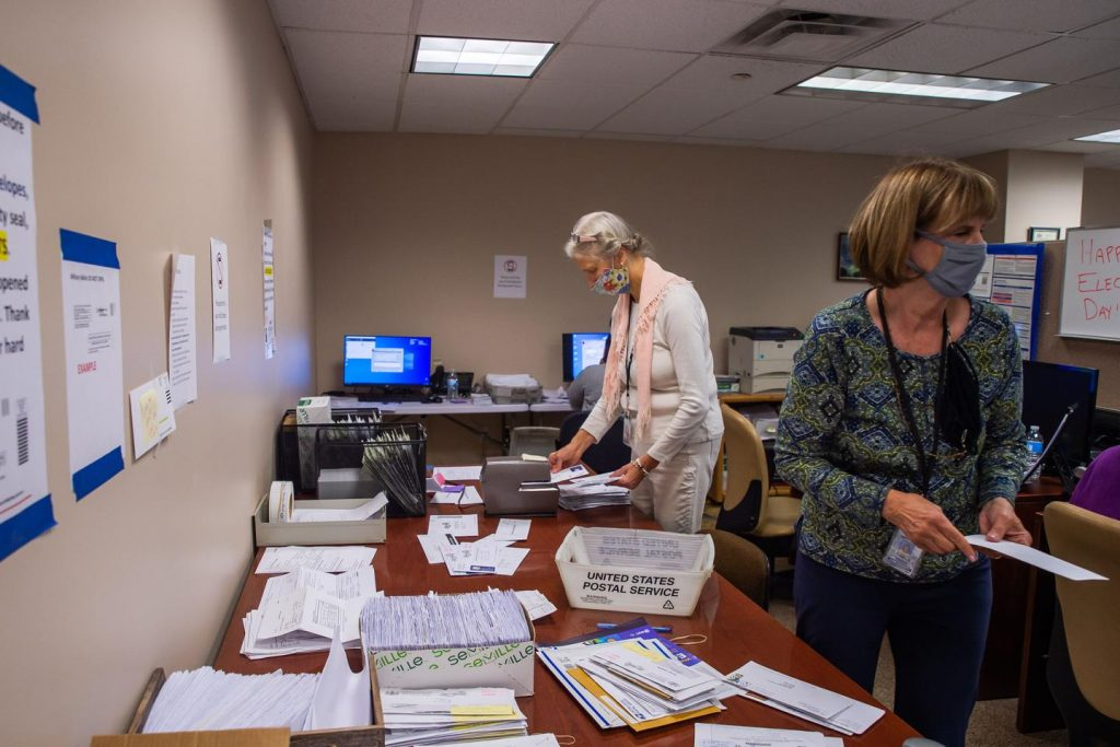 """Erie County employees are seen here organizing mail ballots during the 2020 presidential election. """"We would have had to go to county taxpayers several times without this,"""" Erie County Executive Director Kathy Dahlkemper wrote of the grant money. (Robert Frank for Spotlight PA)"""