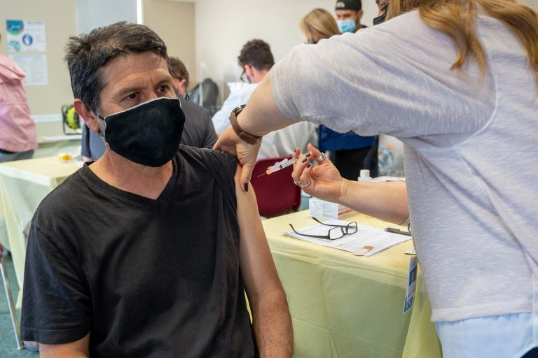 The American Mushroom Institute organized vaccine clinics for Kennett Square's farm workers. (Mark Rutt/Design Design for American Mushroom Institute)