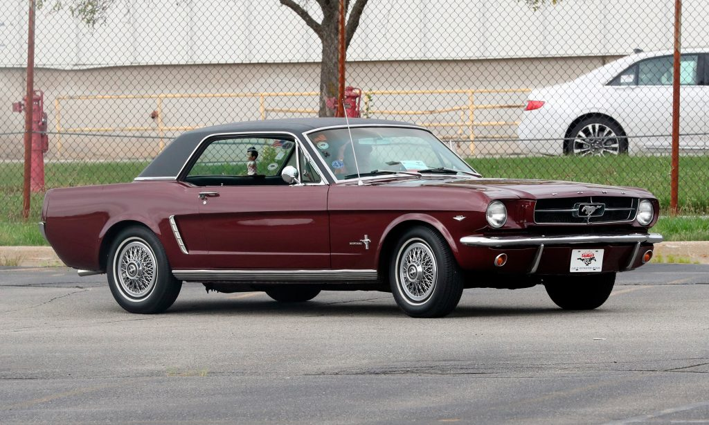 A 1964 Ford Mustang is driven outside the the Flat Rock Assembly plant, Wednesday, Aug. 8, 2018 in Flat Rock, Mich. (AP Photo/Carlos Osorio)