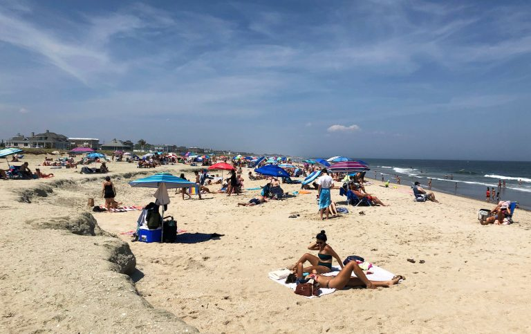 Beachgoers spend time at Monmouth Beach, N.J., Sunday, July 5, 2020. (AP Photo/Eric Carvin)