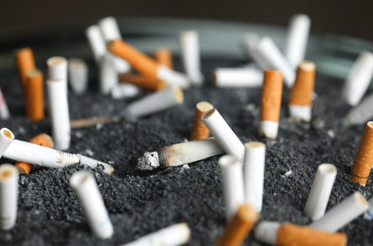 FILE - This March 28, 2019 photo shows cigarette butts in an ashtray in New York. On Tuesday, March 9, 2021. Lung cancer is the nation's top cancer killer, causing more than 135,000 deaths each year. Smoking is the chief cause and quitting the best protection. (Jenny Kane/AP Photo)