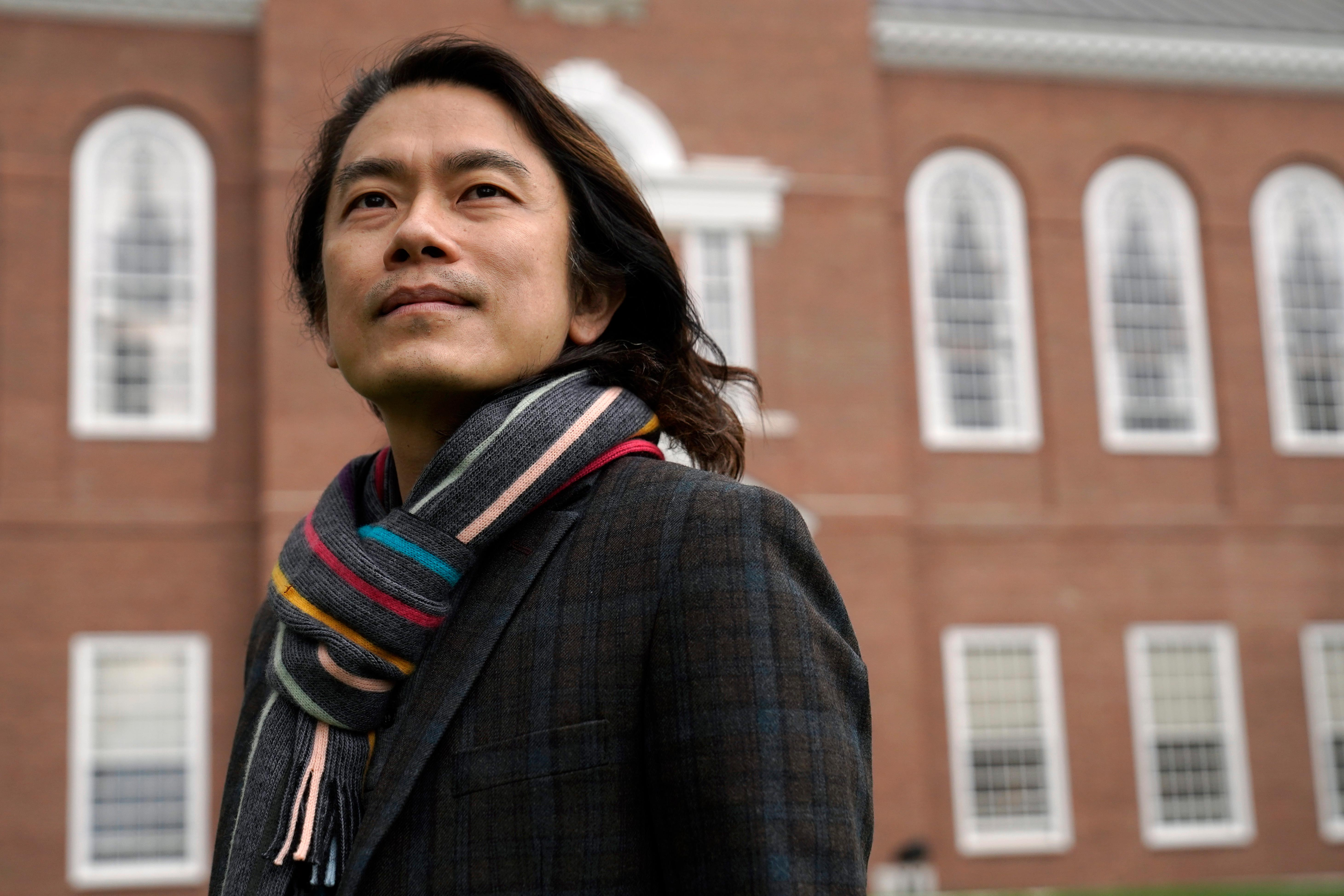 Eng-Beng Lim, a professor at Dartmouth College, stands for a photograph on the school's campus, Tuesday, April 20, 2021, in Hanover, N.H. (AP Photo/Steven Senne)