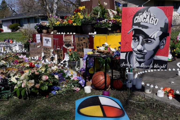 A makeshift memorial is seen Thursday, April 22, 2021, in Brooklyn Center, Minn., near the site of the fatal shooting of Daunte Wright by a police officer during a traffic stop. (AP Photo/Morry Gash)