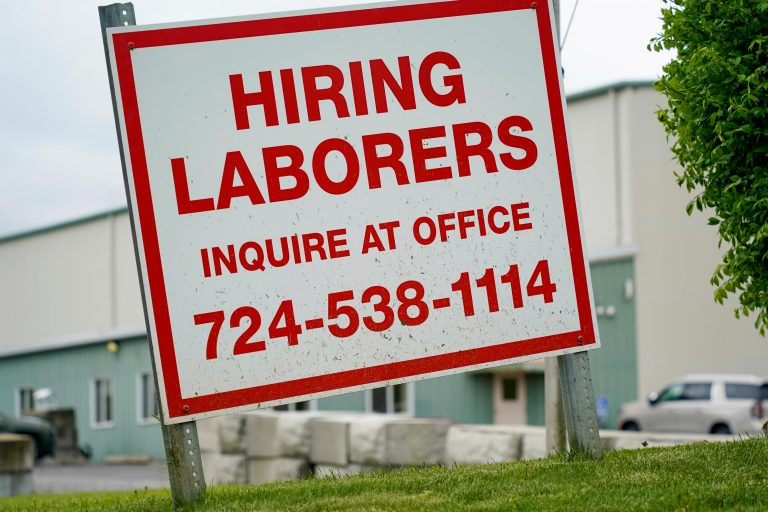 A sign seeking to hire laborers is posted outside a concrete products company in Evans City, Pa., Wednesday, May 5, 2021. A bill by Pennsylvania's Republican-controlled Legislature to reinstate work-search requirements for people claiming unemployment benefits cleared the House Labor and Industry Committee on a party-line vote Tuesday. Labor and Industry Committee Chairman Jim Cox, R-Berks, contends that employers are having trouble finding workers, and that they often blame the additional $300 per week in federal unemployment benefits during the pandemic and the lack of a work-search requirement. (AP Photo/Keith Srakocic)