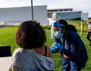 In this May 6, 2021, file photo, Kendria Brown, a nurse with DC health, vaccinates a woman with the Johnson & Johnson COVID-19 vaccine at The REACH at the Kennedy Center in Washington. (AP Photo/Jacquelyn Martin, File)
