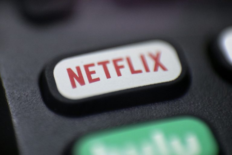 FILE - This Aug. 13, 2020 file photo shows a logo for Netflix on a remote control in Portland, Ore. Streaming services ranging from Netflix to Disney+ want us to stop sharing passwords. That's the new edict from the giants of streaming media, who hope to discourage the common practice of sharing account passwords without alienating their subscribers, who've grown accustomed to the hack. (AP Photo/Jenny Kane, File)