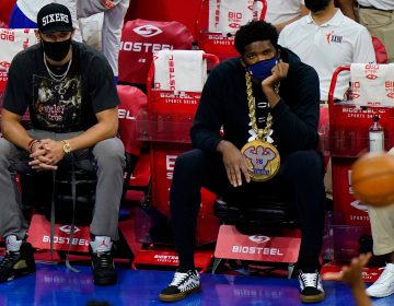 Philadelphia 76ers' Joel Embiid, right, and Ben Simmons watch from the bench during an NBA basketball game against the Orlando Magic, Sunday, May 16, 2021, in Philadelphia. (AP Photo/Matt Slocum)