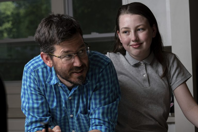 Jay Wamsted, left, and his daughter, Kira, are photographed on Thursday, May 20, 2021 in Smyrna, Ga. Wamsted, who is an 8th grade math teacher, allowed his daughter to skip testing this year. (AP Photo/Ben Gray)