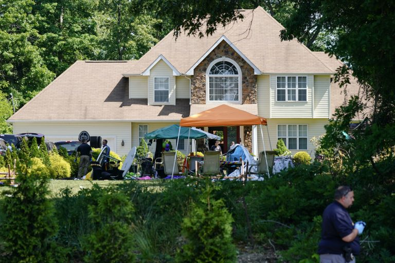 Investigators work the scene of a mass shooting at a Fairfield Township home