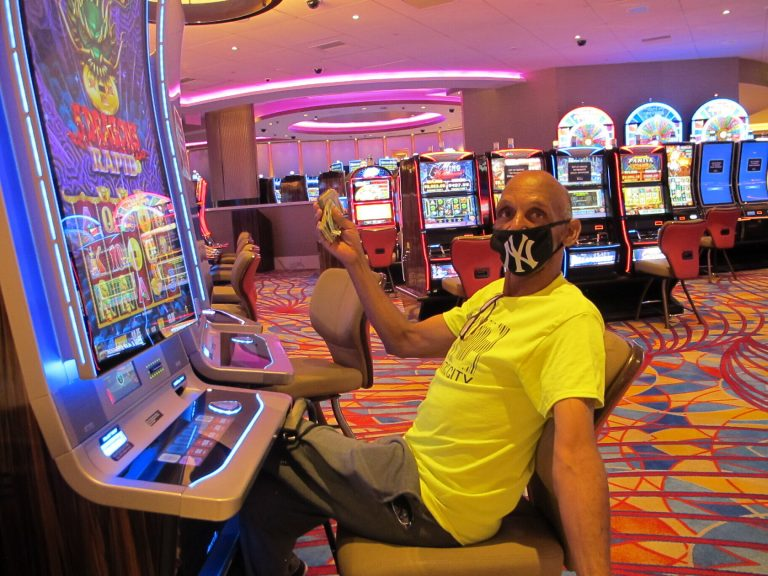 Gary Royster of Atlantic City holds up a wad of cash he used to gamble at the Hard Rock casino in Atlantic City