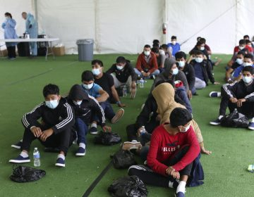 Young migrants wait to be tested for COVID-19 at the Donna Department of Homeland Security holding facility