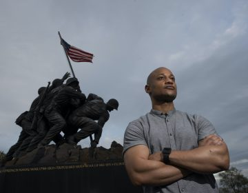 Reserve Marine Maj. Tyrone Collier stands with his arms crossed in front of the U.S. Marine Corps War Memorial
