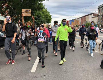 Black Lives Matter protesters led by Romel Clark (center) march through Fishtown on June 2, 2020. (Layla A. Jones/WHYY)