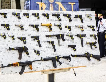 An ATF board displays some the types of firearms confiscated in Philadelphia. (Kimberly Paynter/WHYY)
