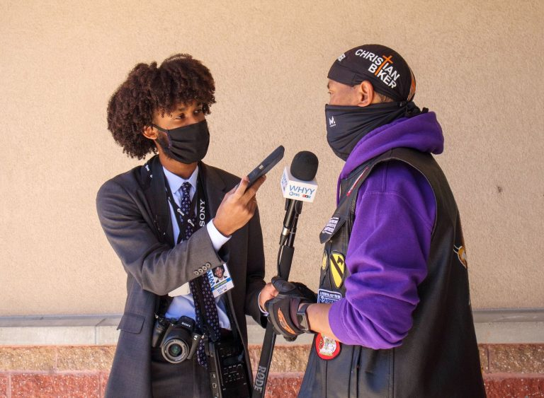 WHYY's suburban reporter Kenny Cooper conducts an interview. (Langston Collins)