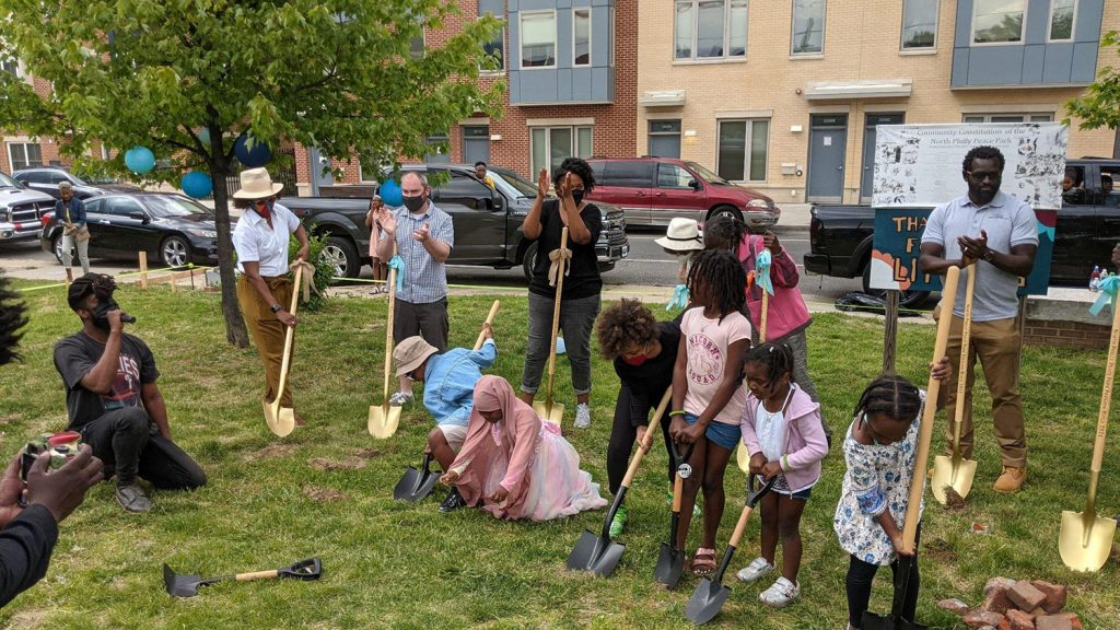 North Philly Peace Park volunteers and Sharswood community members break ground on the pavilion at a May 15 ceremony. (Courtesy of Kermit O)