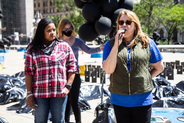 Rosalind Pichardo and Aleida Garcia stand at a rally