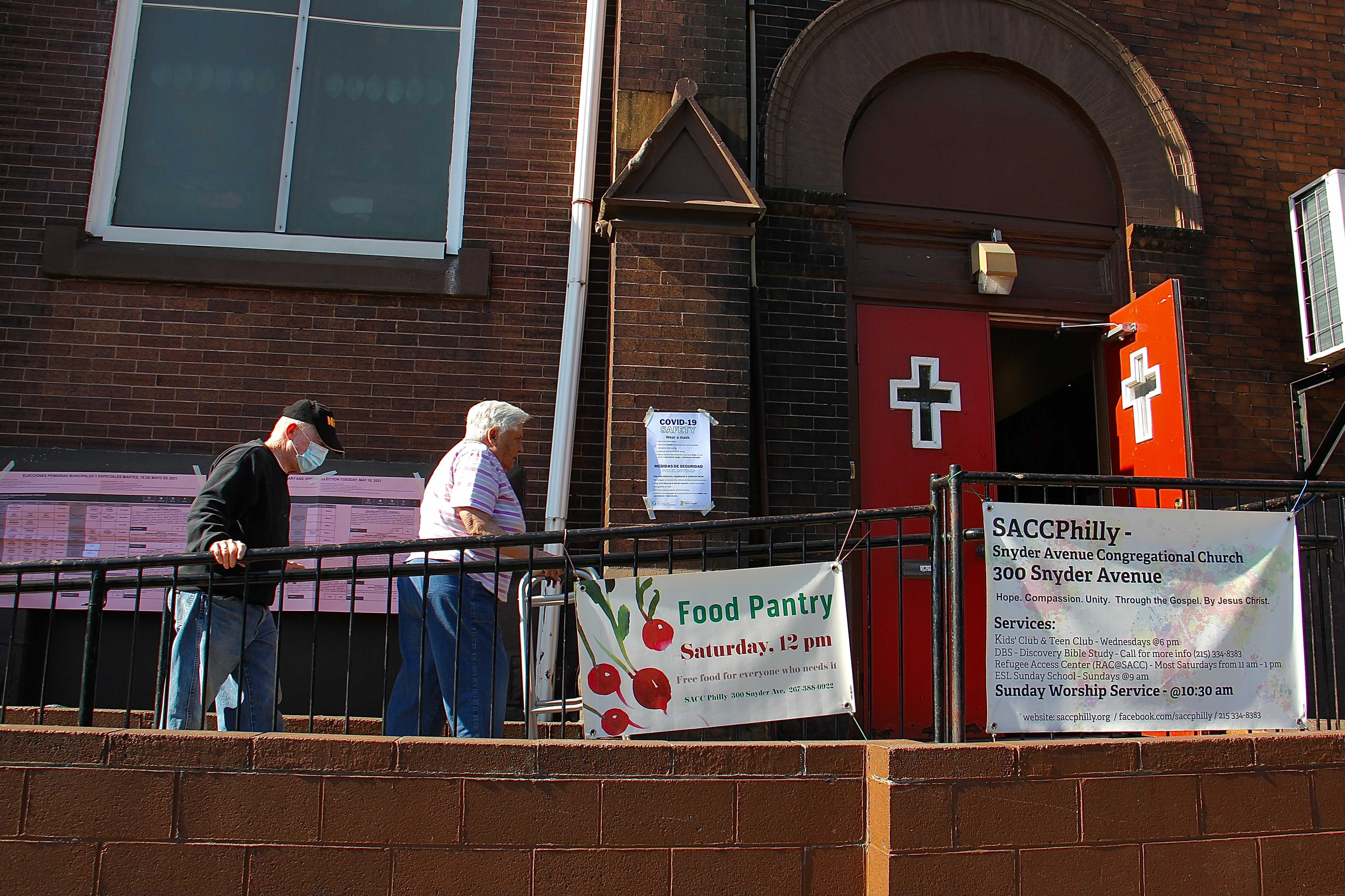 Voters arrive at Snyder Avenue Congregational Church to vote