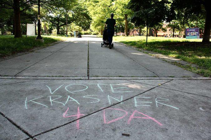 Sidewalk chalk shows support for incumbent District Attorney Larry Krasner in Jefferson Square Park