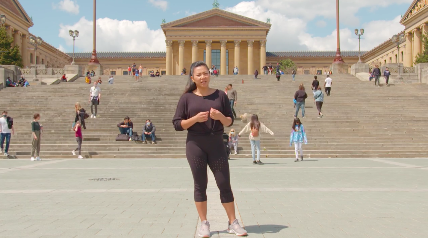One of the subjects of Visit Philly's marketing videos, Marisel, opened a fitness studio five weeks before the pandemic shutdown. She's excited to have friends and family come to the city again. (Screenshot)