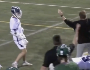 A local school district is apologizing after video captures a volunteer coach punching a player during a lacrosse game. (Screenshot)