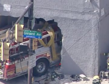 A fire truck crashed into a building at 7th Street and Girard Avenue Thursday afternoon. (Screenshot via 6ABC)