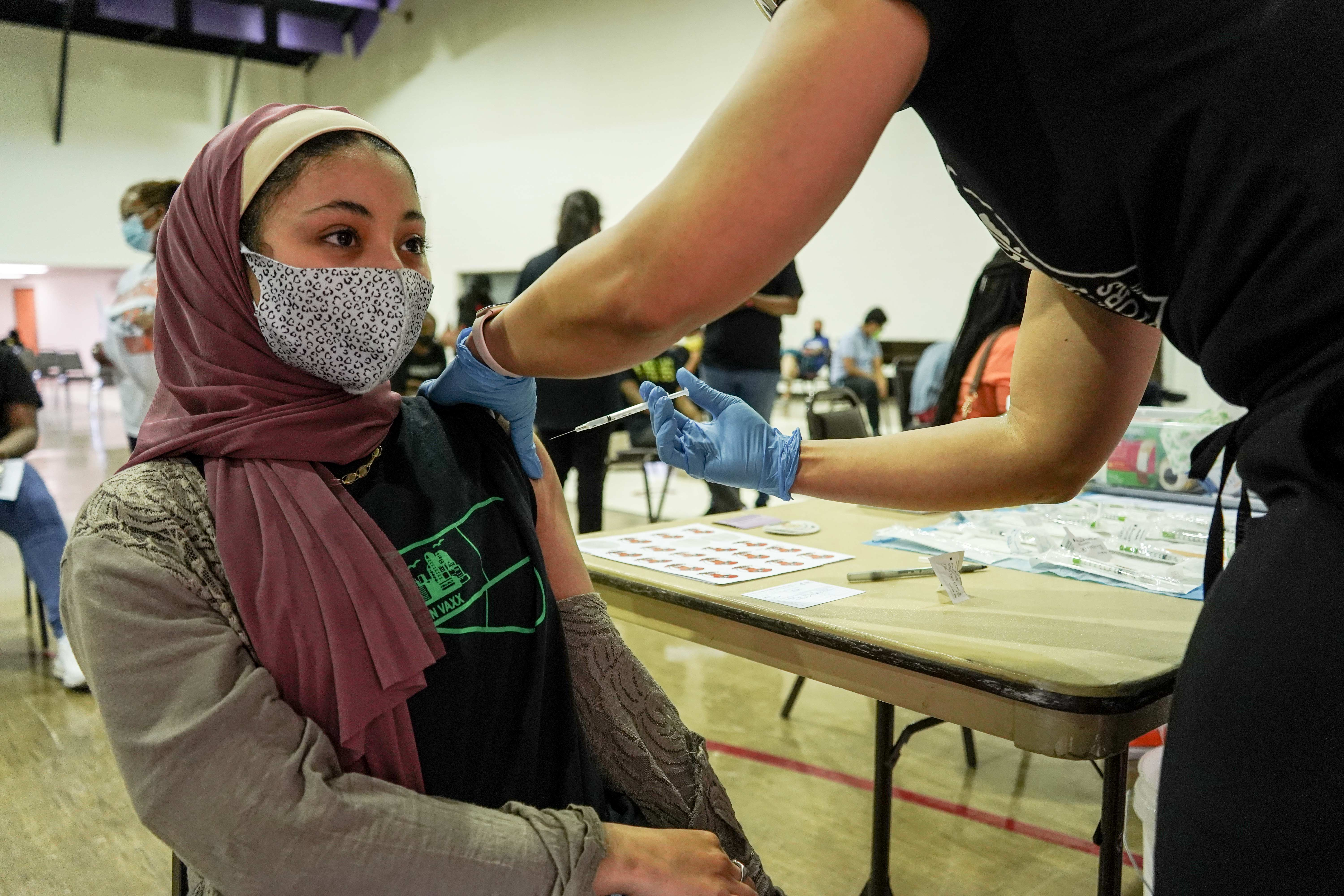 Ibtihal Gassen, a junior at Central High School and a student ambassador with Philly Teen Vaxx, got her first shot at the North Philadelphia clinic on May 15, 2021. (Kenny Cooper/WHYY)