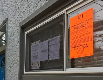 A 2019 property violation notice on display in a Fishtown home's window