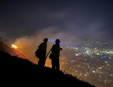Firefighters battle a brush fire in Santa Barbara, Calif. Climate-driven droughts make large, destructive fires more likely around the world. Scientists warn that humans are on track to cause catastrophic global warming this century. (Santa Barbara County, Calif., Fire Department via AP)