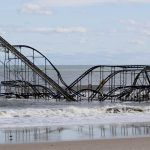 A rollercoaster that once sat on the Funtown Pier in Seaside Heights, N.J., rests in the ocean on Wednesday, Oct. 31, 2012 after the pier was washed away by superstorm Sandy. (Julio Cortez/AP)