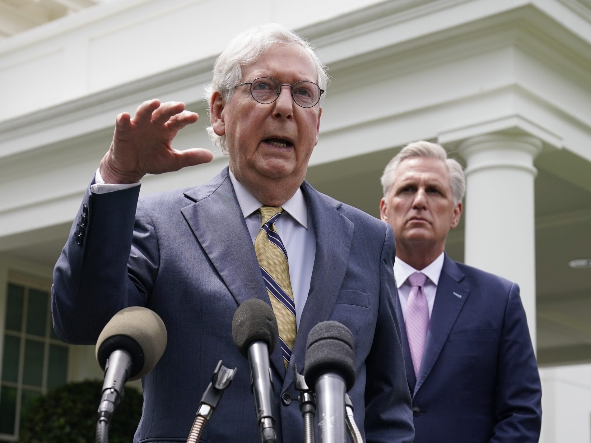 Senate Minority Leader Mitch McConnell, left, and House Minority Leader Kevin McCarthy speak to reporters outside the White House after meeting with President Biden Wednesday. (Evan Vucci/AP Photo)