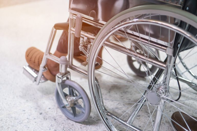 Person's legs in wheelchair
