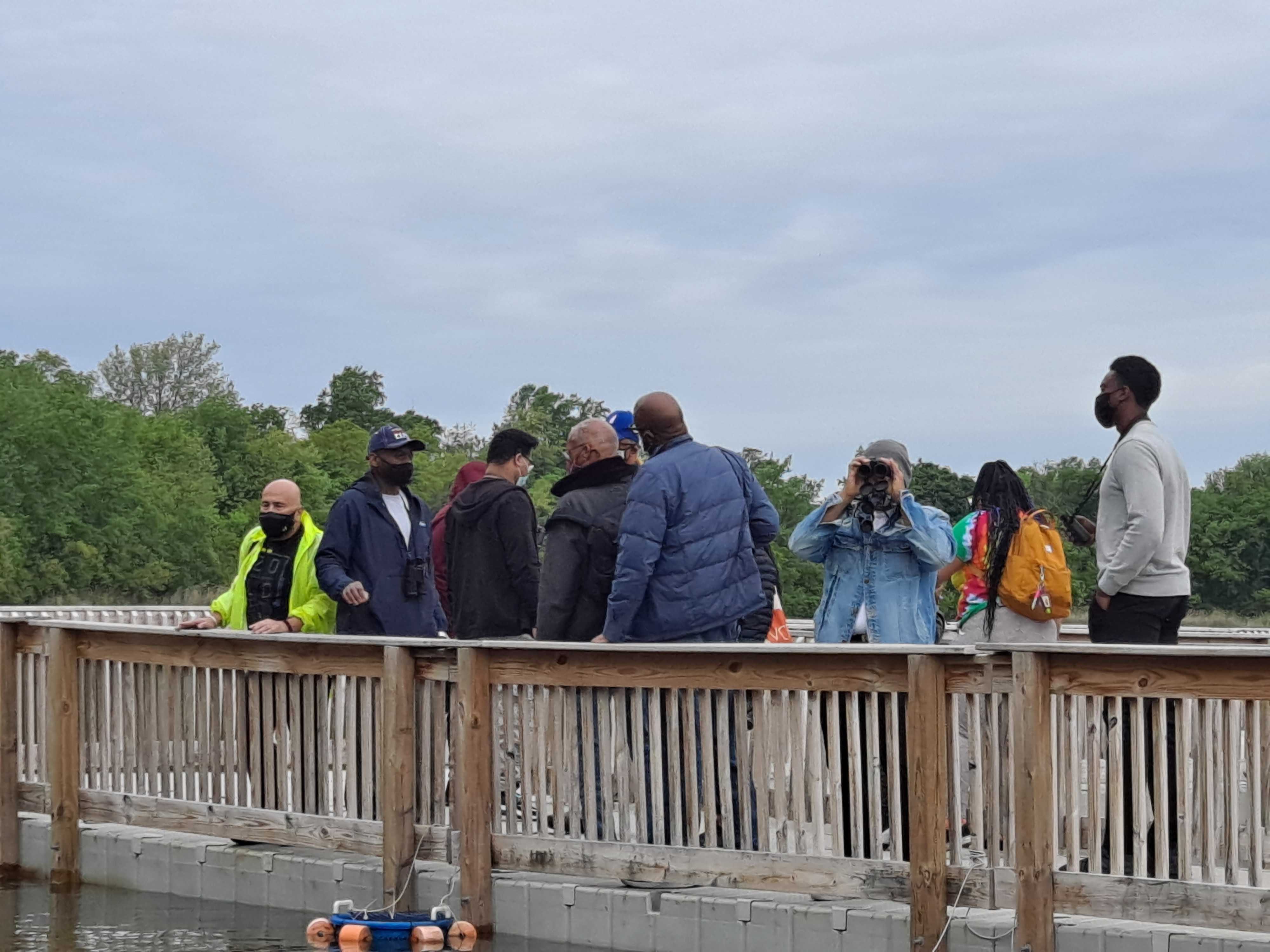 Keith Russell teaches people how to identify different birds around Fairmount Park.