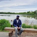 Keith Russell sits on a bench at Fairmount Park