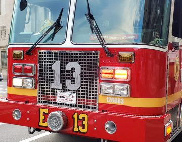 The front of an Engine 13 fire truck