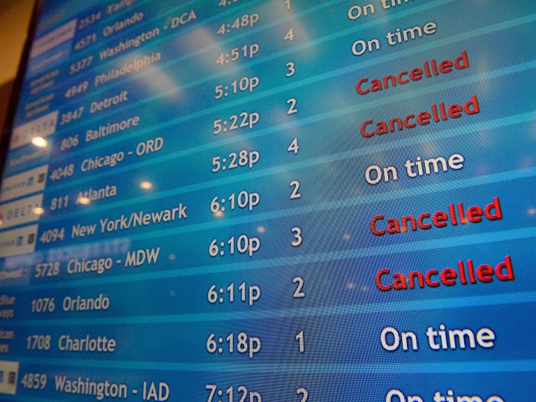 A screen shows canceled incoming flights at T.F. Green International Airport in Warwick, R.I., on March 30, 2020. Consumer advocates and two senators say airlines are sitting on nearly $15 billion in refunds owed to customers for canceled travel. (Joseph Prezioso/AFP via Getty Images)