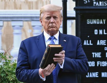 Then-President Trump holds up a Bible outside of St John's Episcopal Church on June 1, 2020, after days of anti-racism protests against police brutality. President Biden has rescinded several orders Trump made during his last year in office, including moves to protect Confederate statues being dismantled by protesters last year. (BRENDAN SMIALOWSKI/AFP via Getty Images)